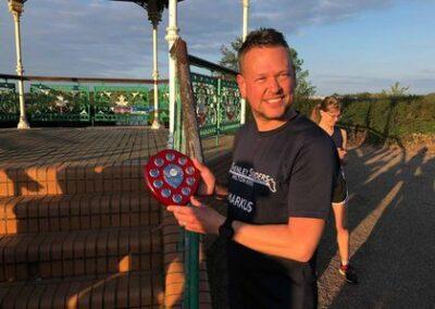 Markus wins Striders 5K challenge